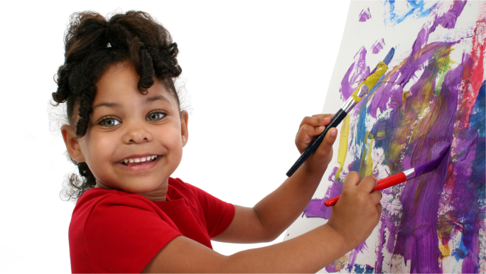 cute little girl playing with paint