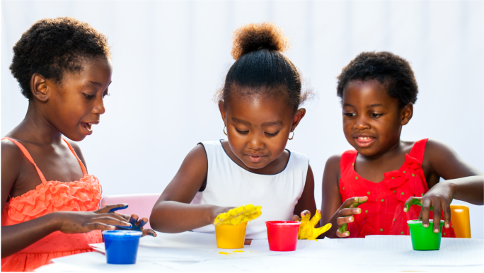 african america kids playing with paints