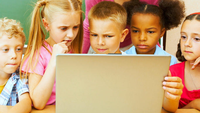 group of children watching something in a board