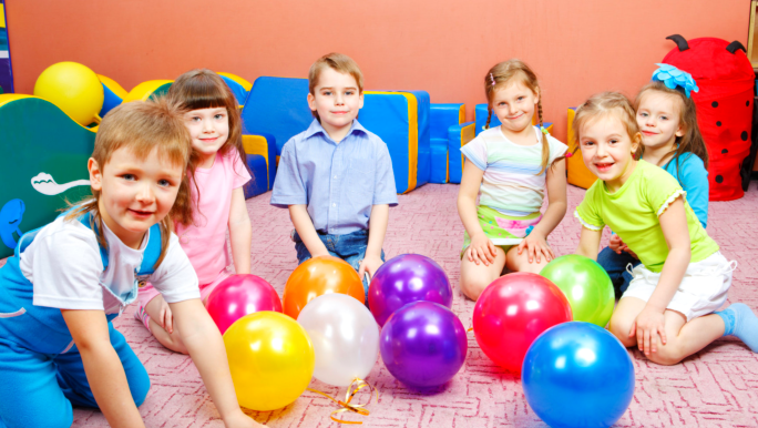 group of children playing in a playroom