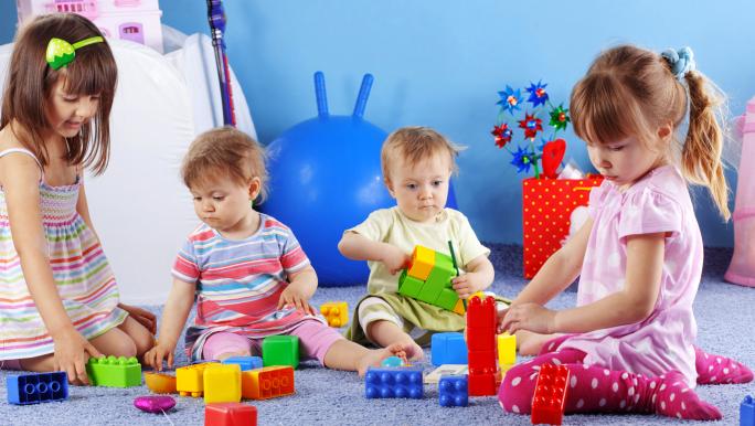 infant playing lego